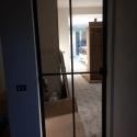 enkele deur met 4 klein ruiten