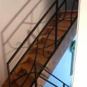 Gesmede trapleuning ontworpen door de klant.