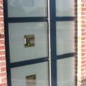 RVS deurgreep over de hele lengte van de deur.