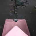 Koperen dakkap met koets en windwijzer.