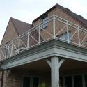 Klassieke balustrade met kruizen en bollen in RAL kleur.